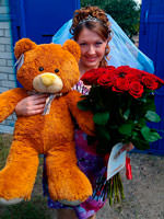 Giant teddy bear with roses